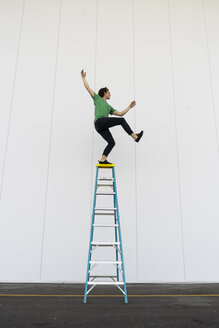 Acrobat balancing on ladder - AFVF00906