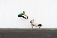 Two acrobats doing tricks together, jumping mid-air - AFVF00924