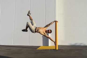 Acrobat training on a pole - AFVF00966