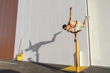 Acrobat training on a pole - AFVF00972