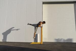 Acrobat training on pole - AFVF00978