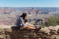 USA, Arizona, Grand Canyon National Park, Grand Canyon, mother and little daughter looking at view - GEMF02180