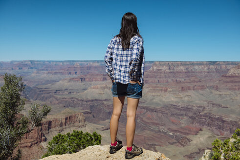 USA, Arizona, Grand Canyon National Park, Grand Canyon, back view of woman looking at view - GEMF02183