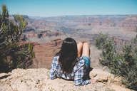 USA, Arizona, Grand Canyon National Park, Grand Canyon, back view of woman looking at view - GEMF02186