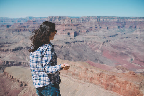 USA, Arizona, Grand Canyon National Park, Grand Canyon, woman looking at view - GEMF02195