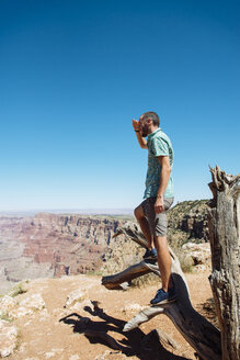 USA, Arizona, Grand Canyon National Park, Grand Canyon, man looking at view - GEMF02204