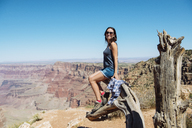USA, Arizona, Grand Canyon National Park, smiling woman at Grand Canyon - GEMF02210