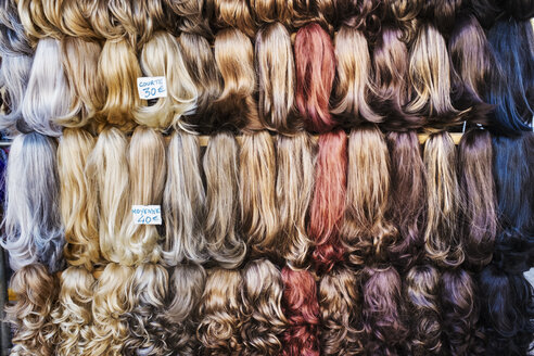 A display of hair extensions and hair pieces of different colours. - MINF01125