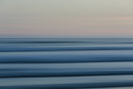 Ocean waves and the view to the horizon over the sea at dusk from the beach. - MINF01128