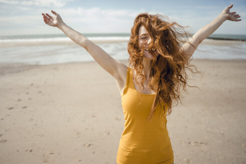 Redheaded woman, laughing happily in the wind - KNSF04214