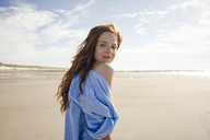 Woman on the beach, looking over shoulder - KNSF04247