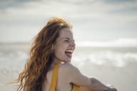 Laughing woman having fun on the beach - KNSF04316