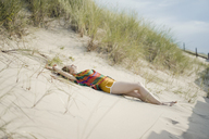 Woman relaxing on the beach - KNSF04334