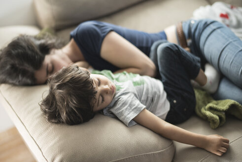 Mother and son taking a nap on couch - JASF01899