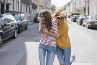 Two girlfriends having fun in the city, running - JOSF02402