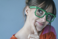 Young woman wearing pixel glasses, smiling - JOSF02435