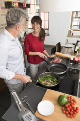 Couple in kitchen, preparing food toghether - FKF03092
