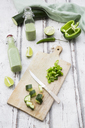 Glass bottle of homemade green Gazpacho and ingredients - LVF07328