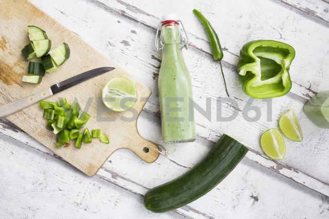 Glass bottle of homemade green Gazpacho and ingredients - LVF07331