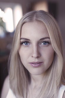 Portrait of young blond woman with blue eyes - KMKF00398