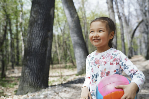 Little girl playng with a ball in a park - AZF00021