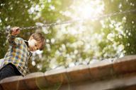 Male toddler crossing wooden footbridge - ISF17174