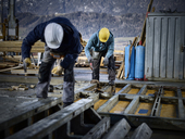 Construction workers working on plywood - CVF00989