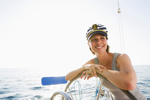 Smiling woman steering boat - ISF17386