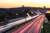 Germany, Baden-Wuerttemberg, Stuttgart, Autobahn A8 in the evening, light trails - WDF04768