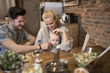 Happy young parents spending time in kitchen at home with their baby girl - AWF00122