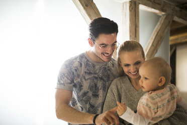 Happy young parents spending time at home with their baby girl - AWF00131