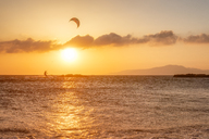 Spain, Andalucia, Tarifa, kite surfer at sunset - SMAF01091