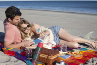 Couple sharing picnic on beach, Breezy Point, Queens, New York, USA - ISF18330