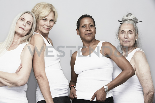 Studio portrait of senior women friends posing for camera - ISF18521