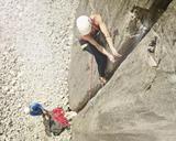 Austria, Innsbruck, Martinswand, woman climbing in rock wall - CVF00997