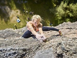 Austria, Innsbruck, Hoettingen quarry, woman climbing in rock wall - CVF01006