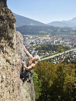 Austria, Innsbruck, Hoettingen quarry, woman climbing in rock wall - CVF01015