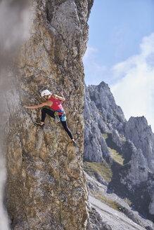 Austria, Innsbruck, Nordkette, woman climbing in rock wall - CVF01021