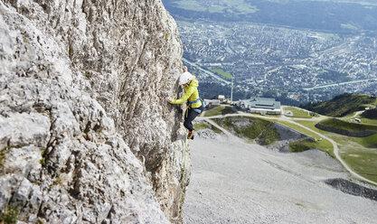Austria, Innsbruck, Nordkette, woman climbing in rock wall - CVF01027