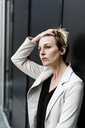 Portrait of pensive businesswoman - GIOF04018