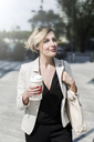 Portrait of relaxed businesswoman with Coffee to go - GIOF04024