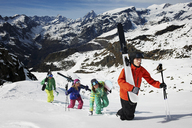 Group of skiers climbing mountain with ski equipment - ISF18531
