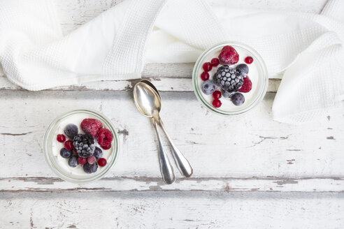 Two glasses of Greek yogurt with frozen berries - LVF07351