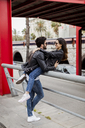 Spain, Barcelona, happy young couple embracing in the city - MAUF01588