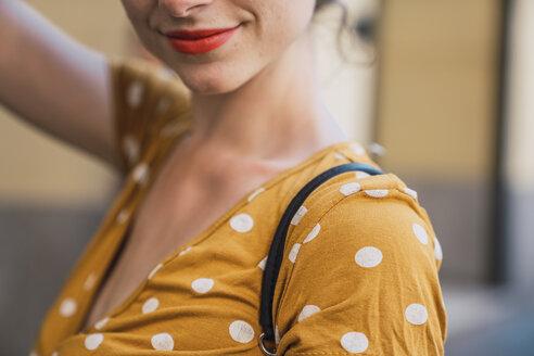 Beautiful woman wearing yellow dress with polka dots - KKAF01284