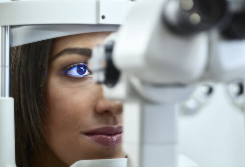 Optician, Young woman during eye test - CVF01034