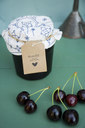 Glass of homemade cherry jam and cherries - GISF00344