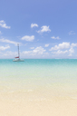 Mauritius, Grand Port District, Pointe d'Esny, sailing boat in turquoise water, blue sky and clouds - MMAF00424