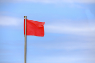 Red flag blowing in the wind - MMAF00436