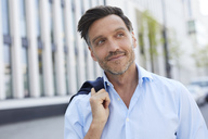 Portrait of relaxed businessman with stubble - PNEF00809